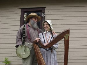 Curtis and Loretta with banjo and harp
